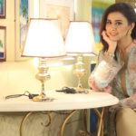 Madiha Naqvi sitting in hot style